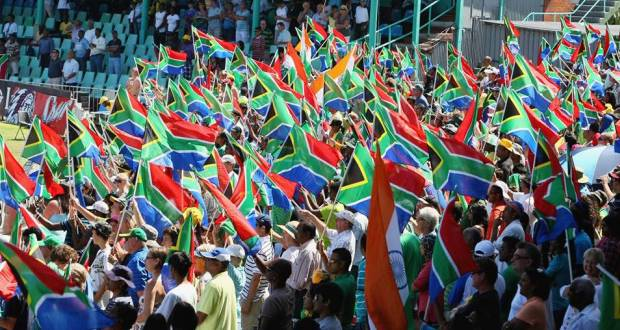 South Africa Fans cheer their nation from cricket stadium with their flag